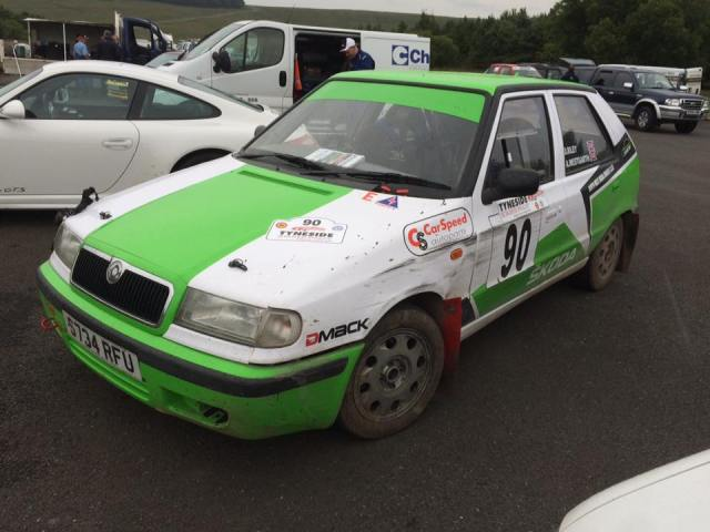 """Battle-scarred, extra """"go-faster"""" stripes, but very happy! Andy Westgarth's Skoda after the Tyneside Stages 2015."""